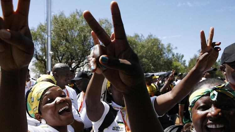 Ruling party African National Congress (ANC) delegates sing and dance as they gesture for a second term for their president Jacob Zuma during the opening of their elective conference at the University of the Free State in Bloemfontein, South Africa, Sunday, Dec. 16, 2012. Zuma addressed some 4,000 delegates as they gathered for the start of the party's Mangaung conference, being held in the city, also known as Bloemfontein. (AP Photo/Themba Hadebe)