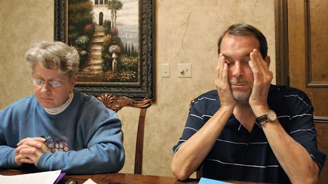 In this Nov. 29, 2012 photo, Dennis O'Brien, right, rubs his head while sitting next to his wife, Kaye O'Brien, left, in Nashville, Tenn. Dennis O'Brien contracted fungal meningitis after receiving a series of steroid injections in his neck made by a Massachusetts pharmacy that has been linked to an outbreak of fungal meningitis. (AP Photo/Kristin M. Hall)