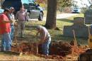 "In this photo made from video and released by WSFA-TV, workers labor to exhume the body of a John Doe buried in Alabama in 1981, in Scottsboro, Ala. on Thursday, Oct. 9, 2014. The FBI is exhuming the body of a John Doe buried in Alabama in 1981 in its search for a 10 Most Wanted Fugitive accused of killing his family with a sledgehammer nearly 40 years ago. In court filings, the FBI said there is a strong resemblance between photos of the John Doe and former State Department diplomat William Bradford ""Brad"" Bishop Jr. (AP Photo/WAFF-TV)"