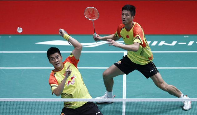 China's Fu Haifeng with partner Cai Yun plays a shot during their men's doubles match against Indonesia's Saputro Rian Agung and Pratama Angga in Kuala Lumpur