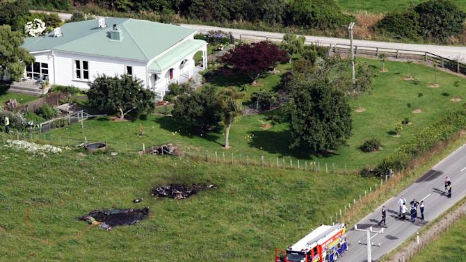 FILE - This Jan. 7, 2012 file aerial photo, shows the burned areas where a hot air balloon crashed after it caught on fire in Carterton, New Zealand. The hot air balloon struck power lines and exploded, crashing to the ground and killing all 11 people on board. (AP Photo/Wairarapa Times, Lynda Feringa, File)