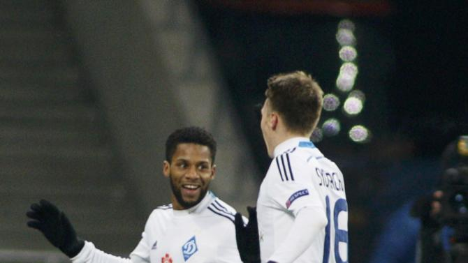 Dynamo Kiev's Jeremain Lens celebrates his goal with team mate Serhiy Sydorchuk during their Europa League soccer match against Rio Ave at the Olympic stadium in Kiev