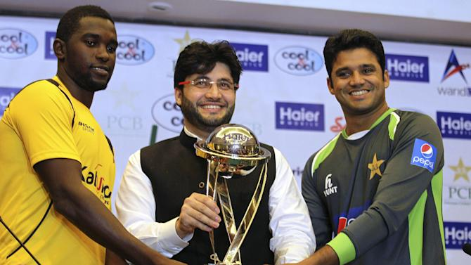 Pakistan's captain of the one-day international cricket team, Azhar Ali, right, Javed Afridi, CEO of Haier Home Appliances, the main sponsor for the ODI series, and Zimbabwe captain Elton Chigumbura, left, hold the ODI series trophy at the Gaddafi Stadium in Lahore, Pakistan, Monday, May 25, 2015. Pakistan will try and carry its winning momentum against Zimbabwe into their one-day international series from Tuesday, knowing nothing less than a 3-0 win would keep them in contention for next year's Champions Trophy. (AP Photo/K.M. Chaudary)