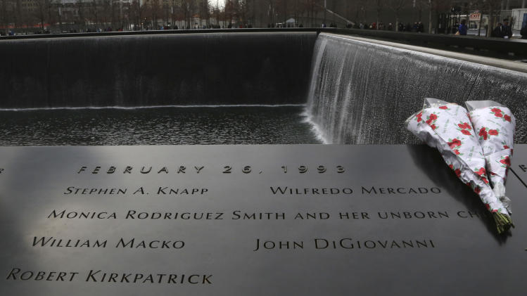 Flowers are placed near the names of the six people who were killed 20 years ago in the first terrorist attack on the World Trade Center in New York, before the start of a ceremony to remember them Tuesday, Feb. 26, 2013. About 50 people attended the ceremony, held at the 9/11 memorial, where the twin towers were destroyed eight years later. (AP Photo/Mary Altaffer)