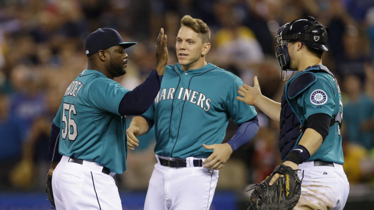 Seattle Mariners closer Fernando Rodney, left, is greeted by Logan Morrison, center, and catcher Mike Zunino, right, after they defeated the Oakland Athletics 3-2 in a baseball game on Friday, July 11, 2014, in Seattle. (AP Photo/Ted S. Warren)