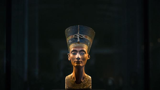 FILE - In this Sept. 10, 2014 file photo, a 3,300-year-old bust of Queen Nefertiti  is displayed at the New Museum in Berlin, Germany. Egypt's antiquities ministry said on Thursday, Nov. 26, 2015 exploration has begun inside King Tutankhamun's 3,300 year-old tomb, in the search for alleged hidden chambers, one of which may include Queen Nefertiti, according to a new theory. (AP Photo/Markus Schreiber, File)