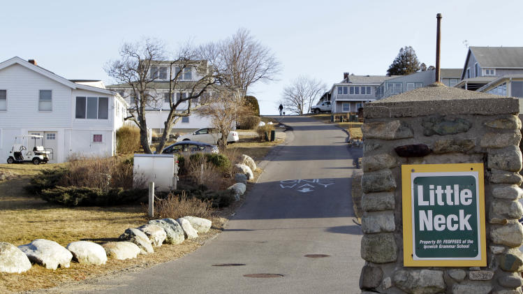 This photo of Wednesday, Feb. 22, 2012, shows the entrance to Little Neck in Ipswich, Mass. The dying wish of William Payne, one of the state's earliest settlers, created the nation's oldest charitable trust and eventually led tenants to build 167 cottages on this land he left for the seaside city. The rent money has generated some $2.4 million to help fund public schools over the last 25 years. Now, the trustees want to tear up the will and convert the property into condominiums. (AP Photo/Elise Amendola)