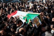 <p>Iranians carry the coffin of a commander shot dead in Syria, during his funeral procession in Tehran on February 14, 2013. Syria's army and rebels were preparing for a major battle for control of strategic airports in Aleppo, a watchdog said, four days after insurgents launched assaults on airbases in the northern province.</p>