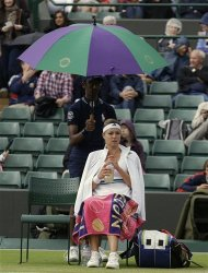 Maria Kirilenko of Russia waits as rain delays play during a quarterfinals match against Agnieszka Radwanska of Poland at the All England Lawn Tennis Championships at Wimbledon, England, Tuesday, July 3, 2012. (AP Photo/Kirsty Wigglesworth)