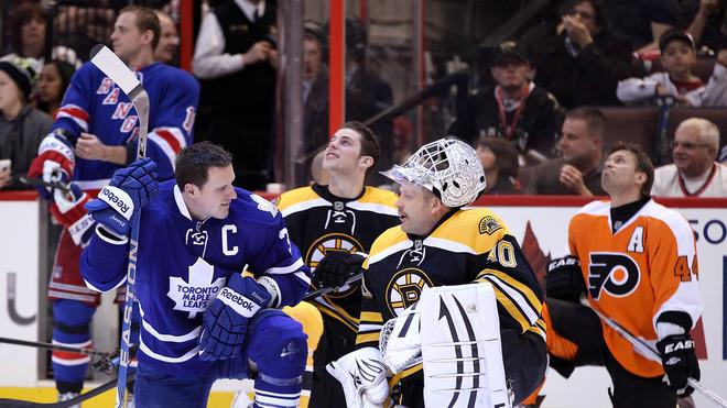Dion Phaneuf #3 Of The Toronto Maple Leafs And Team Chara Talks With Tim Thomas #30 Of The Boston Bruins And Team Getty Images