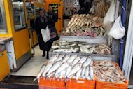 Iranians buy fish at Tajrish Bazaar in Tehran in January 2012. Young Tehranis' struggle to stay in Iran's middle class is becoming increasingly more difficult because of the country's economic straits made much worse by EU and US sanctions
