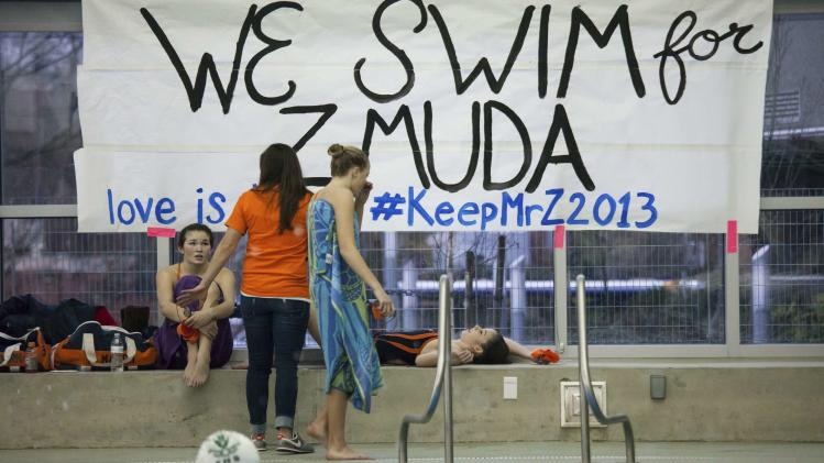A sign supporting former Eastside Catholic High School Vice Principal and swimming coach Mark Zmuda is pictured during a swim meet at Rainier Beach Pool in Seattle, Washington