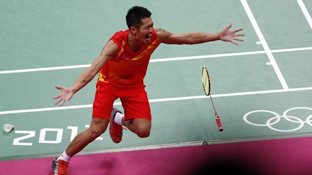 China's Lin Dan celebrates winning his men's singles badminton gold medal match against Malaysia's Lee Chong Wei at the London 2012 Olympic Games at the Wembley Arena