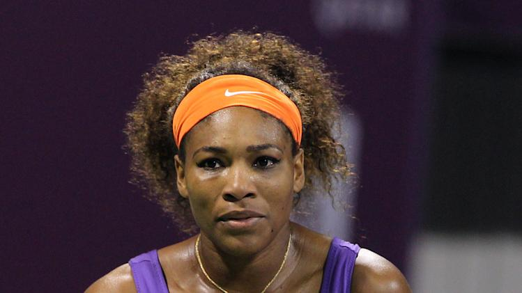 Serena Williams of the U.S. reacts after losing a point against Daria Gavrilova of Russia during the Second day of the WTA Qatar Ladies Open in Doha, Qatar, Tuesday, Feb. 12, 2013. (AP Photo/Osama Faisal)