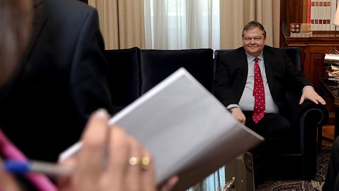 Socialist leader Evangelos Venizelos pauses during his  meeting with Greek President Karolos Papoulias , Saturday May 12 2012. Papoulias' office announced Saturday that the president would meet initially with the heads of the three parties that won the most votes in Sunday's inconclusive elections: the conservative New Democracy, radical left-wing Syriza and socialist PASOK. He will then meet individually with the leaders of the other four parties that won enough votes for parliamentary seats.  (AP Photo/Aris Messinis/Pool)