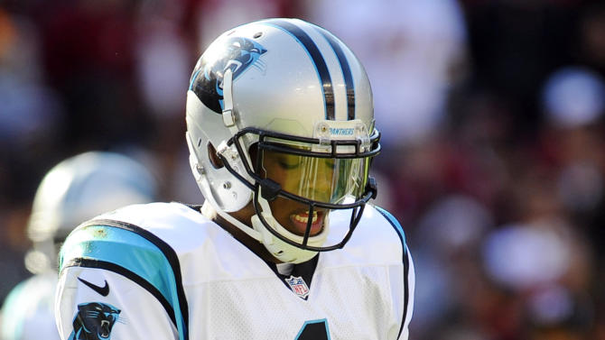 Carolina Panthers quarterback Cam Newton (1) looks at his injured hand during the first half of an NFL football game against the Washington Redskins, Sunday, Nov. 4, 2012, in Landover, Md. (AP Photo/Richard Lipski)