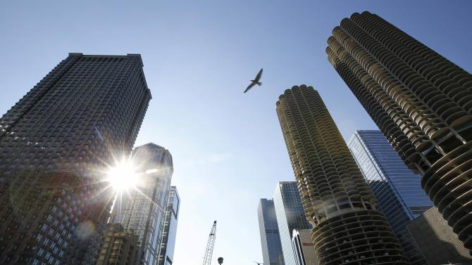 A bird flies between buildings that daredevil Nik Wallenda will walk between on a tightrope without net or harness in Chicago