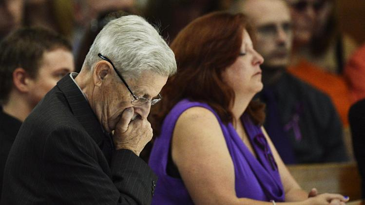 "Theresa Hoover, right, the mother of Aurora, Colo. movie theater shooting victim AJ Boik, sits with her father Bill Hoover, left, during AJ Boik's funeral, Friday, July 27, 2012, at the Queen of Peace Catholic Church, in Aurora, Colo. Boik, 18, was one of twelve people killed in a shooting attack, that also wounded dozens, last Friday at a packed movie theater during a showing of the Batman movie, ""The Dark Knight Rises."" Police have identified the suspected shooter as James Holmes, 24. (AP Photo/Denver Post, Joe Amon, Pool)"