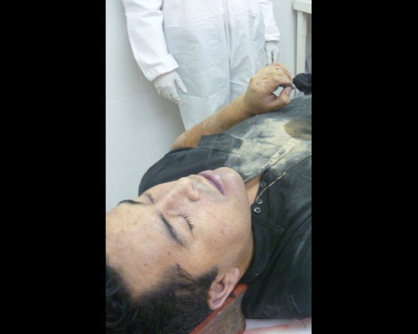 This photo released by Mexico&#39;s Navy on Tuesday, Oct. 9, 2012 allegedly shows the body of Zeta drug cartel leader and founder Heriberto Lazcano while in the possession of Mexico&#39;s Medical Forensic Service (SEMEFO) in Sabinas, Mexico. Mexico&#39;s Navy says fingerprints confirm that cartel leader Lazcano, an army special forces deserter whose brutal paramilitary tactics helped define the devastating six-year war among Mexico&#39;s drug gangs and authorities, was killed Sunday in a firefight with marines in the northern state of Coahuila on the border with the Texas. (AP Photo/Mexico Navy)