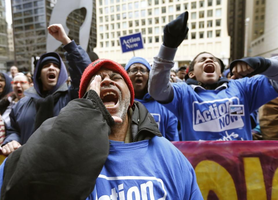 Protesters march against Chicago school closures