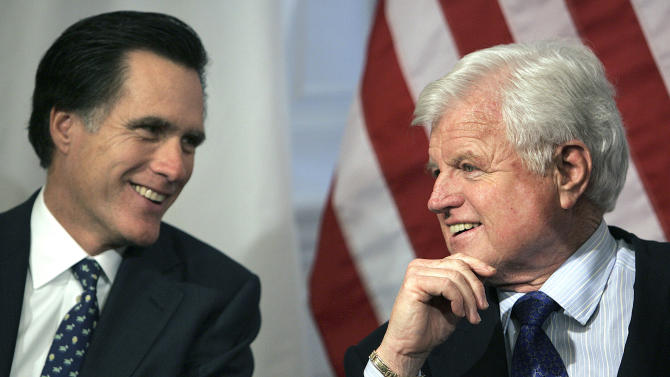 FILE - In a Feb. 4, 2005 file photo, then-Massachusetts Gov. Mitt Romney, left, talks with Sen. Edward Kennedy, D-Mass., at the Statehouse in Boston. Don't expect Romney to spend a lot of time trying to get voters to like him this fall. Instead, the likely Republican presidential nominee will probably rely on a ton of campaign cash and a barrage of nasty attack ads ripping into President Barack Obama for policies that Romney says aren't helping the economy recover fast enough. Look for Romney to take a more moderate tack, too.  (AP Photo/Michael Dwyer, File)