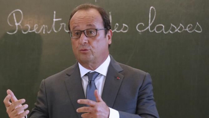 French President Francois Hollande visits the Groupe Le Marais primary school on the first day of the new school year in Pouilly-sur-Serre