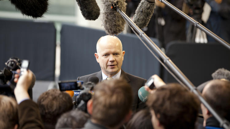 British Foreign Minister William Hague, center, speaks with the media as he arrives for a meeting of EU foreign ministers in Luxembourg on Monday, June 25, 2012. EU foreign ministers on Monday met ahead of an EU summit, to discuss among other issues, the situation in Syria. (AP Photo/Virginia Mayo)