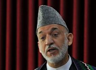 Afghanistan's Western-backed President Hamid Karzai, pictured on July 18, admitted Thursday that his government was corrupt and issued a sweeping directive for reform ahead of the withdrawal of international troops in 2014