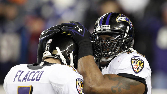 Baltimore Ravens quarterback Joe Flacco (5) and inside linebacker Ray Lewis, right, celebrate near the end of the second half of the NFL football AFC Championship football game against the New England Patriots in Foxborough, Mass., Sunday, Jan. 20, 2013. The Ravens won 28-13 to advance to Super Bowl XLVII. (AP Photo/Stephan Savoia)