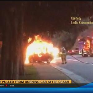 Driver pulled from burning car after crash  4:30 a.m.