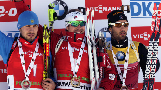 Winner Norway's Emil Hegle Svendsen, center, celebrates his victory with runner up Russia's Anton Shipulin, left and third placed France's Martin Fourcade, following the men's 12.5 km pursuit competition at the Biathlon World Cup event, in Pokljuka, Slovenia, Saturday, Dec. 20, 2014. (AP Photo/Darko Bandic)