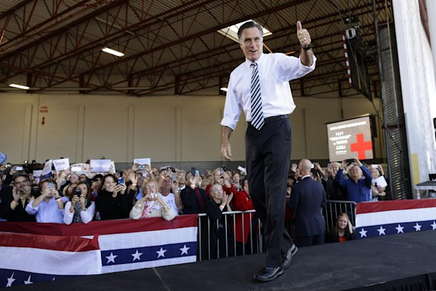 Republican presidential candidate, former Massachusetts Gov. Mitt Romney gives a thumbs up as he arrives at a campaign stop in Tampa, Fla., Wednesday, Oct. 31, 2012. At rear on screen is a number for Red Cross donations for victims of superstorm Sandy. (AP Photo/Charles Dharapak)