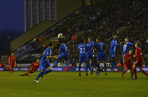 Liverpool's Suarez shoots to score against Wigan Athletic during their English Premier League soccer match in Wigan