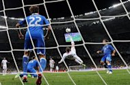 English forward Wayne Rooney (C) performs a bicycle kick during the Euro 2012 football championships quarter-final match England vs Italy on June 24, at the Olympic Stadium in Kiev. The man regarded as the most gifted English footballer of his generation is running out of opportunities to prove that his dazzling debut at Euro 2004 was anything more than a teenage flash in the pan