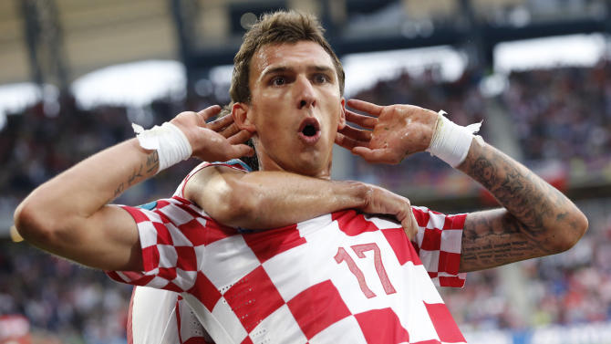 Croatia's Mario Mandzukic celebrates after scoring during the Euro 2012 soccer championship Group C match between Italy and Croatia in Poznan, Poland, Thursday, June 14, 2012. (AP Photo/Antonio Calanni)