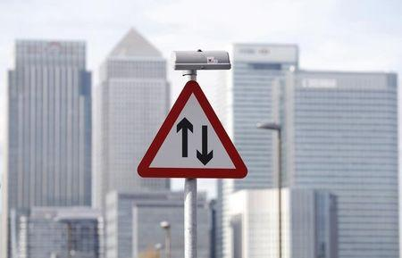 A traffic sign is pictured in front of the skyline of the the Canary Wharf financial district in London