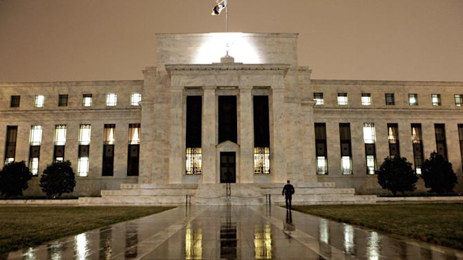 FILE - This March 27, 2009 file photo, shows the Federal Reserve Building on Constitution Avenue in Washington. After a 16-day partial government shutdown and a batch of tepid economic data, no one thinks the Fed is ready to reduce its stimulus when it meets Tuesday and Wednesday, Oct. 29-30, 2013. Many analysts now predict it will maintain the pace of the bond purchases into next year. (AP Photo/J. Scott Applewhite, File)
