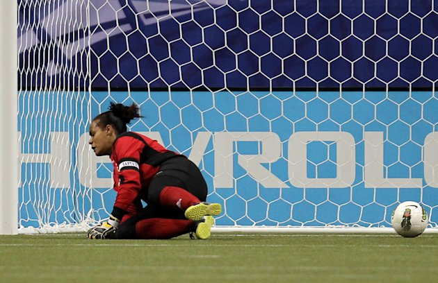 Dominican Republic goalkeeper Heidy Salazar can't block a shot for a goal by United States' Abby Wambach during the first half of a CONCACAF women's Olympic qualifying soccer match in Vancouver, Briti