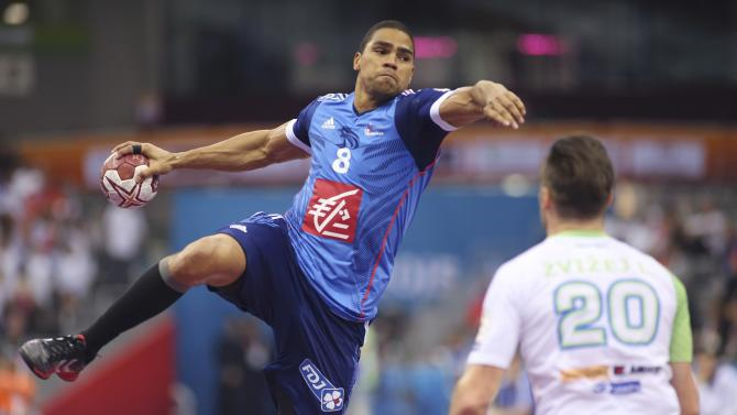 Narcisse of France attempts to score past Zvizej of Slovenia during their quarterfinal match of the 24th Men's Handball World Championship in Doha