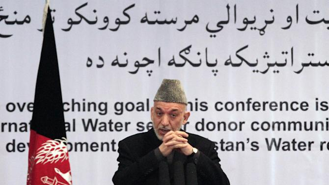 """Afghan President Hamid Karzai gestures, as he speaks during a conference about water management in Kabul, Afghanistan, Tuesday, Jan. 29, 2013. Hamid Karzai. Karzai spoke Tuesday at a conference about water management, where he first talked about the need for clean water systems and then broke off to address what he described as a """"very important issue"""" -- the varied attempts at peace talks with the Taliban -- warning against peace talks with the Taliban without the Afghan government's involvement. (AP Photo/Ahmad Jamshid)"""