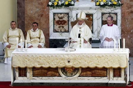 Pope Francis celebrates a mass during his pastoral visit to the Church of S. Maria Regina Pacis in Ostia