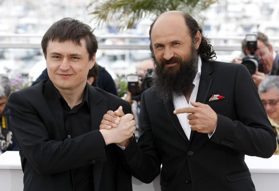 Director Christian Mungiu, left and Valeriu Andriuta pose during a photo call for Beyond the Hills at the 65th international film festival, in Cannes, southern France, Saturday, May 19, 2012. (AP Photo/Lionel Cironneau)
