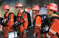 Rescuers head into a coal mine to search for survivers after a gas explosion in Panzhihua, southwest China's Sichuan province on August 29, 2012. The death toll from a gas explosion at a coal mine in China has risen to 37, with another 10 people trapped, authorities said Friday, in one of the country's worst mining accidents of the last year