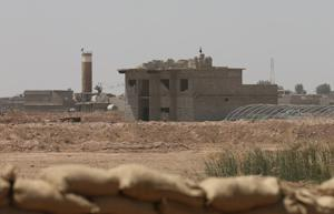 Islamic State of Iraq and the Levant (ISIL) flags flutter…