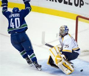 Ebbett, Hansen lead Canucks past Predators, 7-4