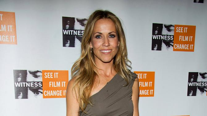 """FILE - In this Dec. 2, 2010 file photo, Sheryl Crow attends the 6th Annual Focus for Change: Benefit Dinner and Concert in support of the human rights group Witness, in New York. The musical based on the film """"Diner"""" has postponed its Broadway opening. Producers said late Sunday night, Jan. 6, 2013, that the Kathleen Marshall-directed show with songs by Sheryl Crow will make its debut on Broadway in the fall, instead of the spring. (AP Photo/Charles Sykes, File)"""