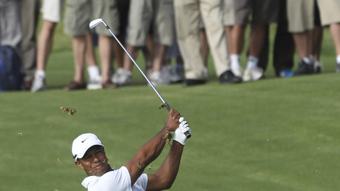 U.S. golfer Tiger Woods plays a shot on the 12th fairway during the second round of the Australian Open golf tournament in Sydney, Australia, Friday, Nov. 11, 2011. Woods started the second round at 4 under the card. (AP Photo/Rob Griffith)