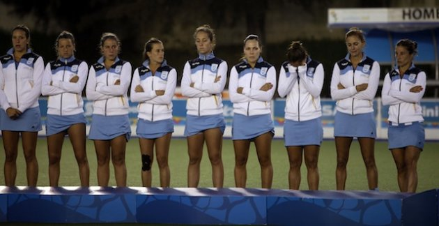 Luciana Aymar, second from right, is unhappy with her Argentina national teammate. (AP)