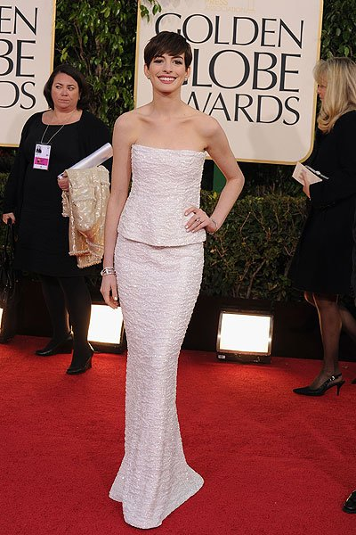 Anne Hathaway: The 'Les Miserables' star and Golden Globe nominee is perfection in a glittering snow white Chanel look. But wait, she's not wearing a dress, she's wearing separates! It's a simple but