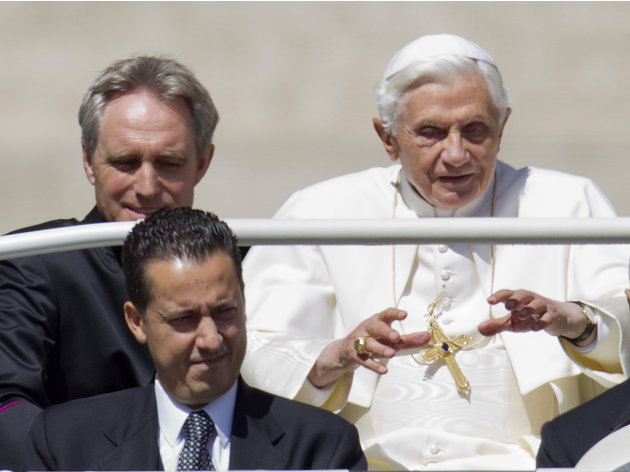 In this photo taken Wednesday, May, 23, 2012, Pope Benedict XVI, flanked by his private secretary Georg Gaenswein, top left, and his butler Paolo Gabiele arrives at St.Peter's square at the Vatica